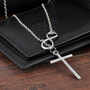 Halssmykke med kors og evighetstegn